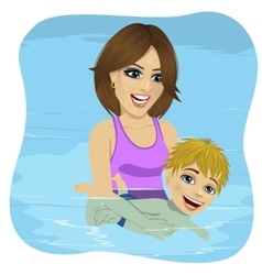 Little boy learning to swim with mother vector image