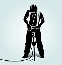 Silhouette of a worker with a jackhammer vector
