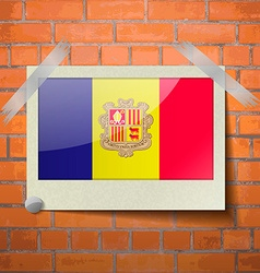 Flags Andorra scotch taped to a red brick wall vector