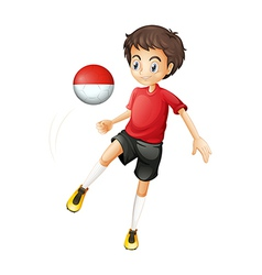 A boy using the ball with the Monaco flag vector