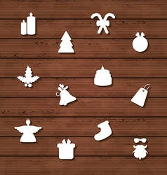 Set Christmas design elements on wooden texture vector image