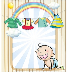 A baby girls clothes hanging vector