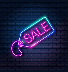 glowing neon tag with word sale on dark brick wall vector image
