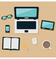 laptop and equipments on the table vector image