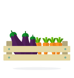 eggplants and carrots in a wooden grocery box vector image
