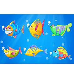 Colorful and smiling fishes under the sea vector image