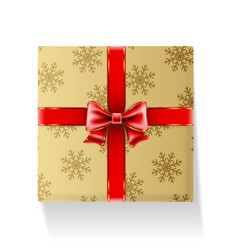 gift packaged in golden box with ribbon and bow vector image vector image