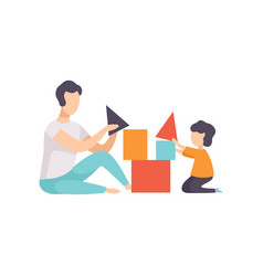 father playing toy cubes with his son dad and his vector image