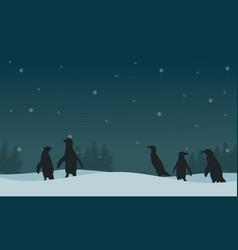 Landscape penguin on hill silhouettes vector