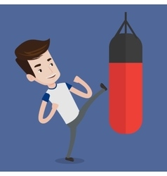 Man exercising with punching bag vector image vector image