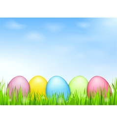 Colored Eggs in Grass vector image