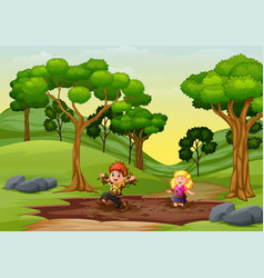 Happy kids playing a mud puddle in nature vector