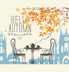 autumn landscape with street cafe in old town vector image