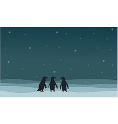 Penguin walking on snow scenery silhouette style vector