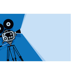 Blue background with old fashioned movie camera vector