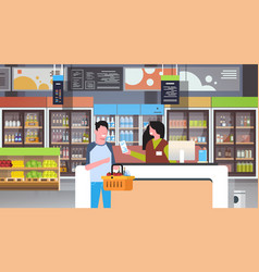 Retail woman cashier at checkout supermarket vector