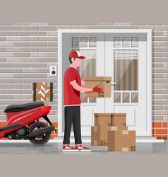 man left cardboard boxes near house facade vector image