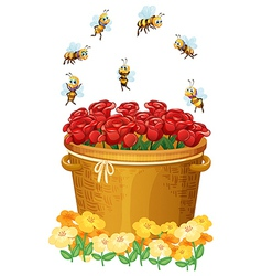 A basket of red roses with bees vector image vector image