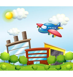 A blue airplane above the tall buildings vector image vector image