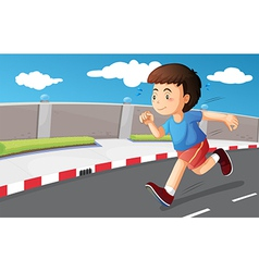 A young boy running at the street vector