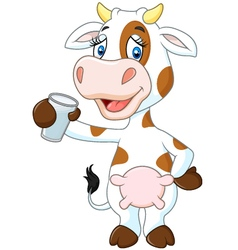 Happy cow animal holding a glass of milk isolated vector