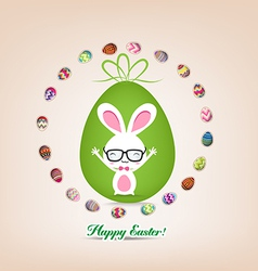 Easter bunny surrounded by eggs vector