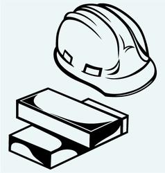 Hard hat and bricks vector image vector image