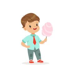 Cartoon little boy standing and holding big stick vector