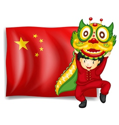 A boy doing the dragon dance in front of the flag vector
