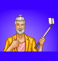 old man with selfiestick and smartphone vector image