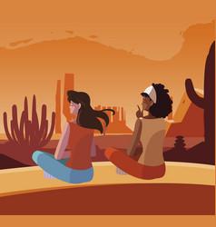 Women contemplating horizon in desert scene vector