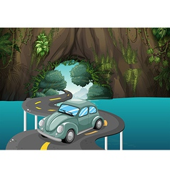 A curve road passing through the cave vector