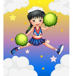 A cheerleader jumping with her green pompoms vector image
