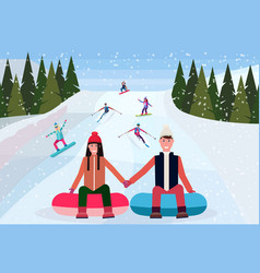 couple sledding on snow rubber tube over vector image