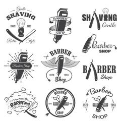 Second set of vintage barber shop emblems vector image