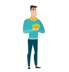 Happy caucasian businessman holding money vector image