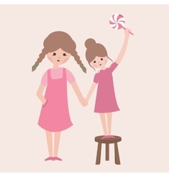 two sisters one is holding candy using stool vector image