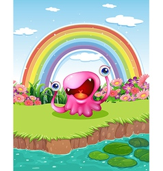 a monster at pond with a rainbow in sky vector image