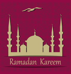 Ramadan kareem cut out of a paper mosque vector