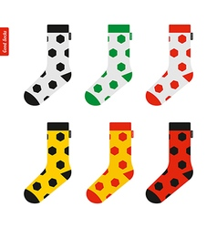 Set of socks with soccer ball pattern in colors of vector