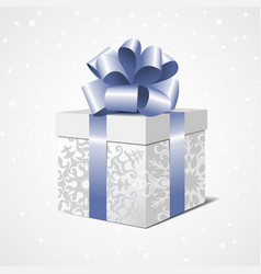 Silver gift box with a blue bow vector
