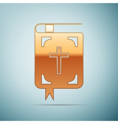 Gold bible icon on blue background vector