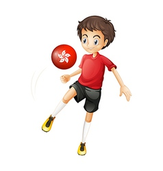 A soccer player using the ball with the flag of vector image vector image