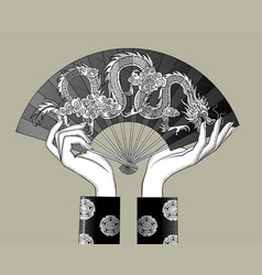 female hands holding a chinese fan vector image