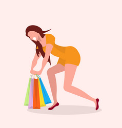 happy girl carrying colorful shopping bags posing vector image