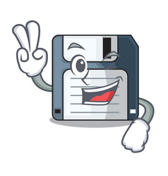 Two finger floppy disk isolated with a mascot vector