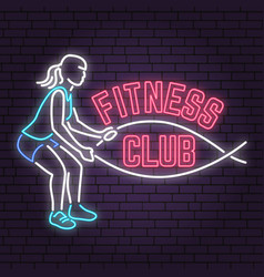 Neon fitness club sign on brick wall background vector