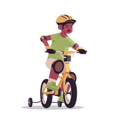Little african american in helmet riding bike vector