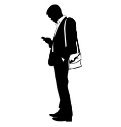 Silhouette of a man in a business suit with phone vector