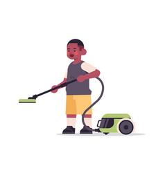Little african american using vacuum cleaner vector